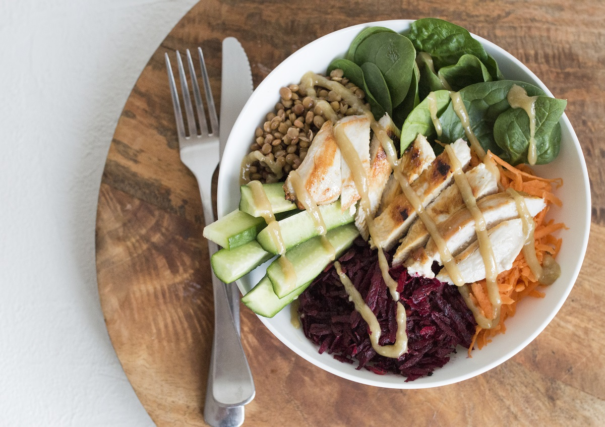 Grilled chicken salad bowl with tahini dressing