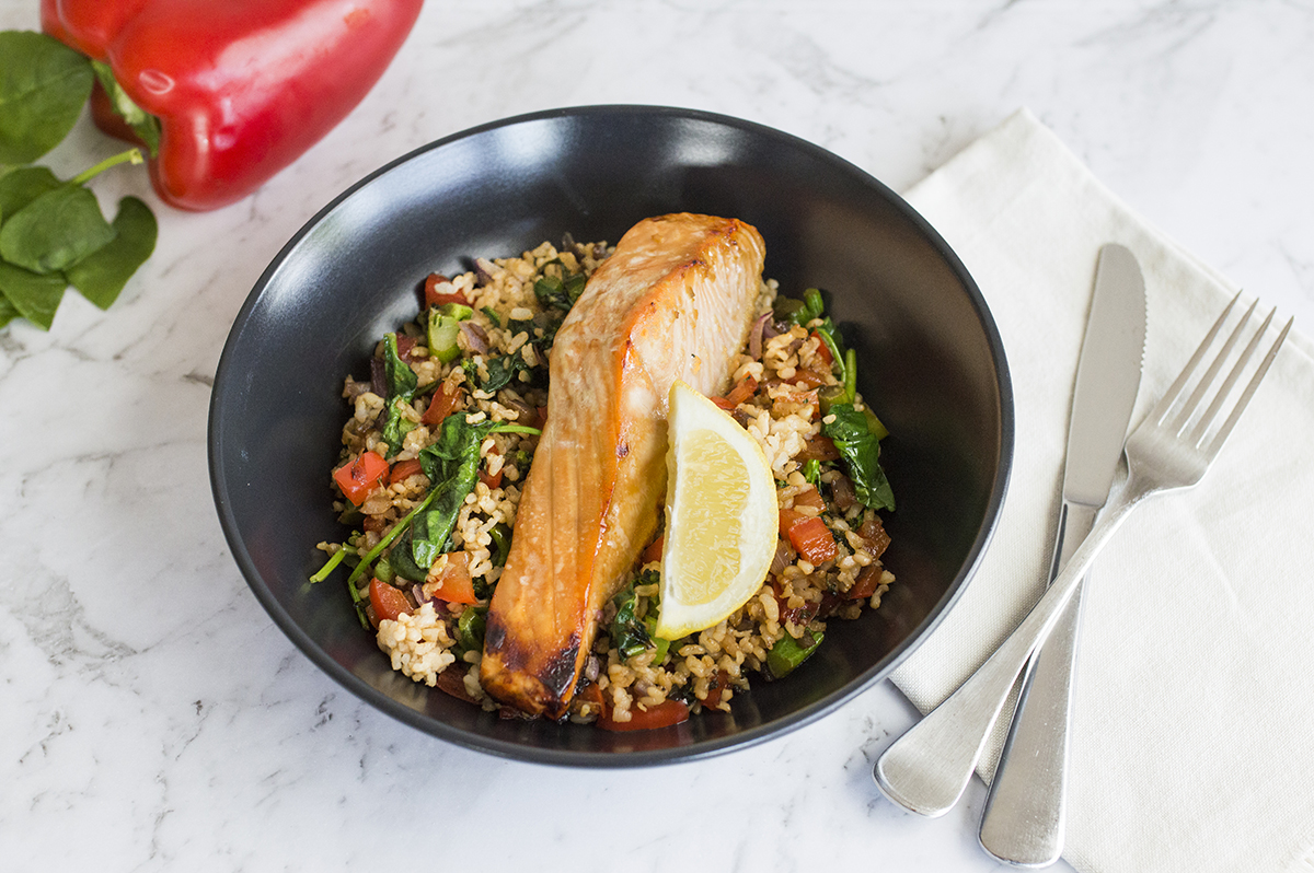 Sticky baked salmon served with brown fried rice