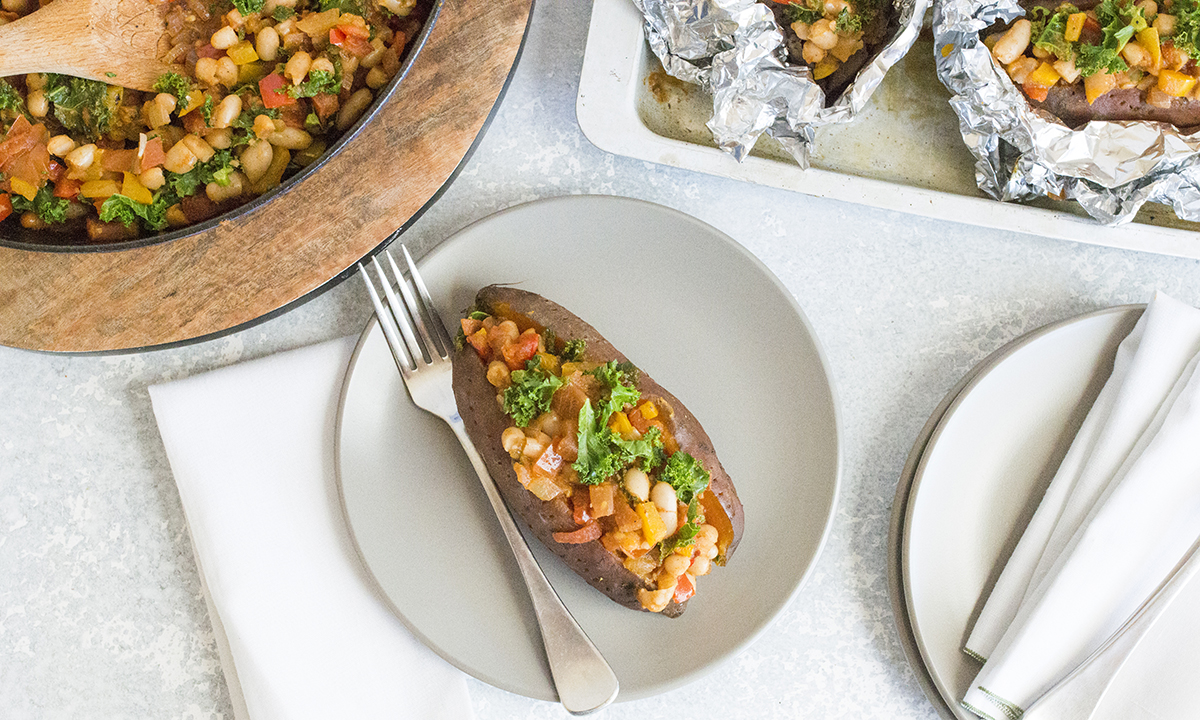 Baked sweet potato with spiced cannellini beans and vegetable stew