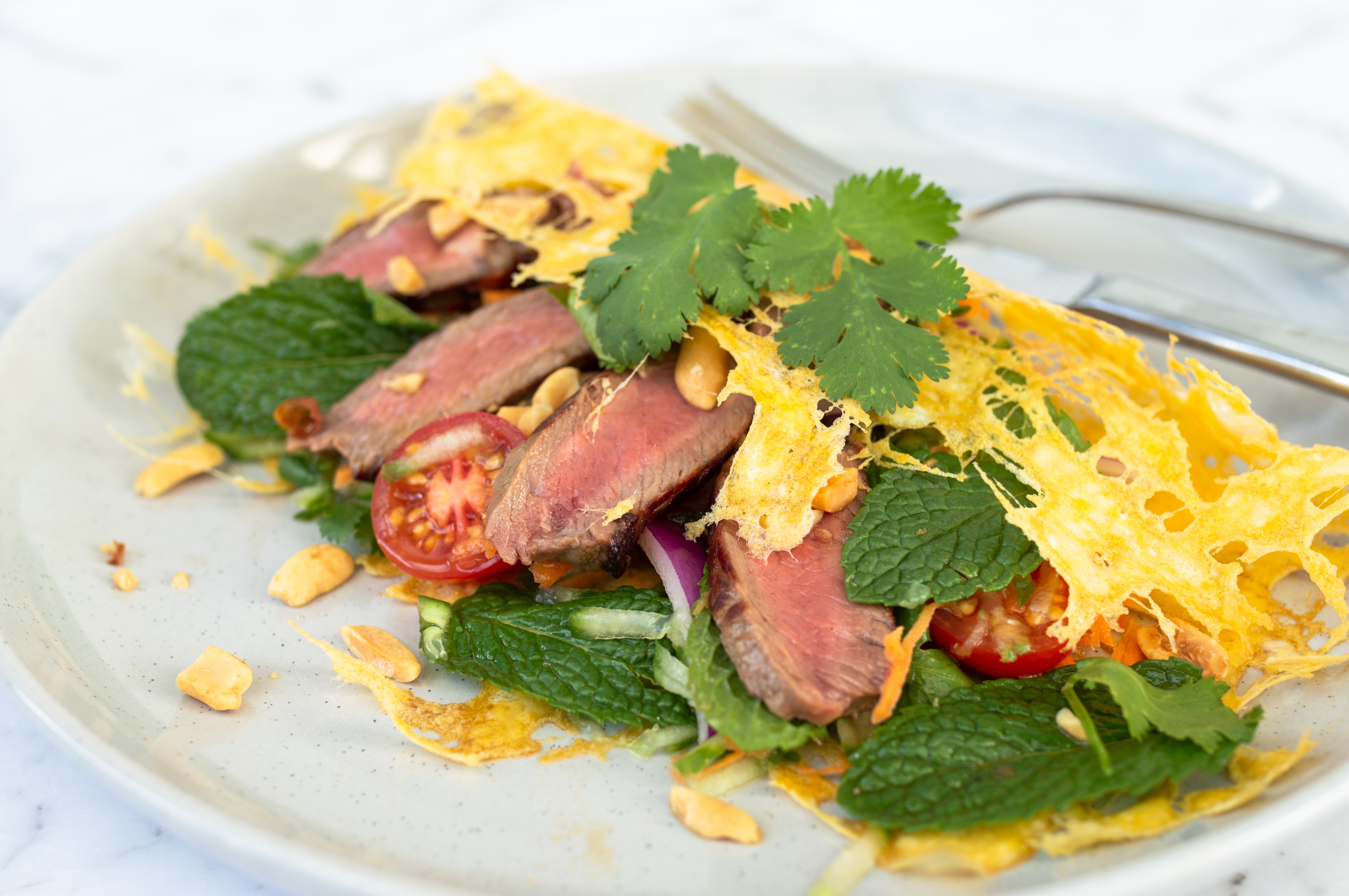 Thai beef salad with egg nest